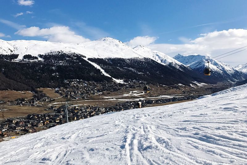 Livigno ,Italy Winter Cold Temperature Mountain Sky Nature Snowcapped Mountain Beauty In Nature Cloud - Sky Tranquil Scene Day Mountain Range Outdoors Scenics Tranquility Frozen No People Landscape Ski Lift