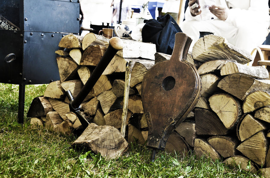 Bellow Bellows Day Field Firewood Grass Land Large Group Of Objects Log No People Outdoors Stack Sunlight Timber Wood - Material