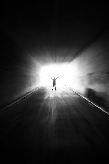 Silhouette of a woman at the end of a tunnel with light streaming in and zoom blur added Underground Alone Bright Darkness Death Divine Dream Entrance Ethereal Freedom Hope Spirit Spirituality Afterlife Corridor Depression Energy Escape Fantasy Holy Silhouette Spirtual Tunnel Urban
