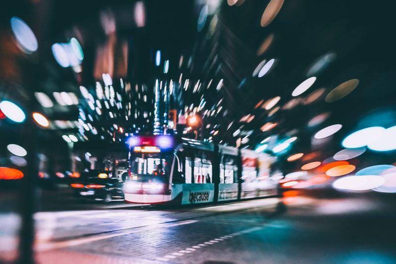 Blurred motion of illuminated car on street at night