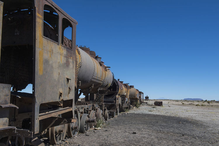 Abandoned train against clear sky