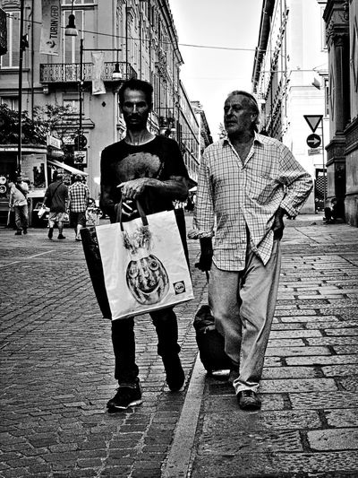 Two of us. Adult Archival Black And White Black And White Photography Bnw City City Life Friendship Homeless Homeless People Lifestyles Olympus Om-d E-m10 Outdoors People Person Portrait Street Street Life Street Photography Torino Italy Turin Turin Italy Walking People Monochrome Photography Fashion Stories Stories From The City Adventures In The City This Is My Skin
