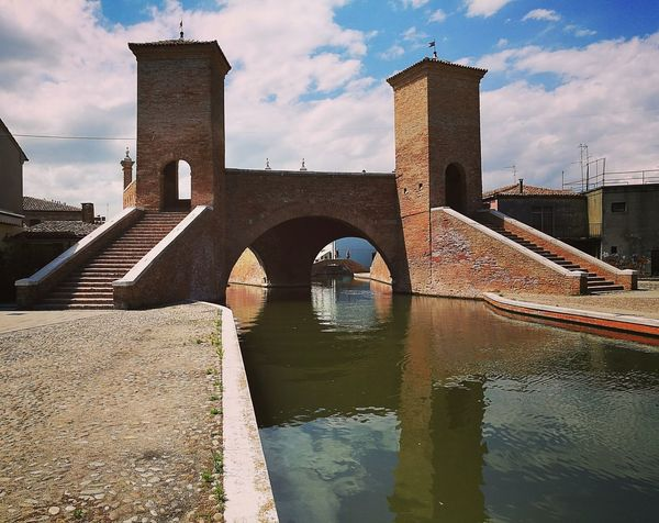 Comacchio | Italy Old Town Italy Comacchio Building Exterior Built Structure Architecture Reflection Sky Travel Destinations Cloud - Sky Bridge - Man Made Structure Outdoors Water Day Cityscape City Urban Skyline No People Skyscraper Eyem City Shots EyeEm Best Shots Eyem Collection Eyem Market Eyem Gallery Sea EyeEmNewHere EyeEm Selects The Week On EyeEm Your Ticket To Europe An Eye For Travel