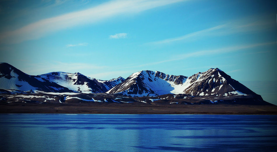 Svalbard Coast in Summer Iceberg Outdoors Mountain Range Nature No People Environment Frozen Landscape Snowcapped Mountain Ice Tranquility Tranquil Scene Water Mountain Beauty In Nature Sky Scenics - Nature Snow Svalbard In Summer Svalbard  Microclimate Spitsbergen Coast Spitsbergen Arctic Circle Copy Space