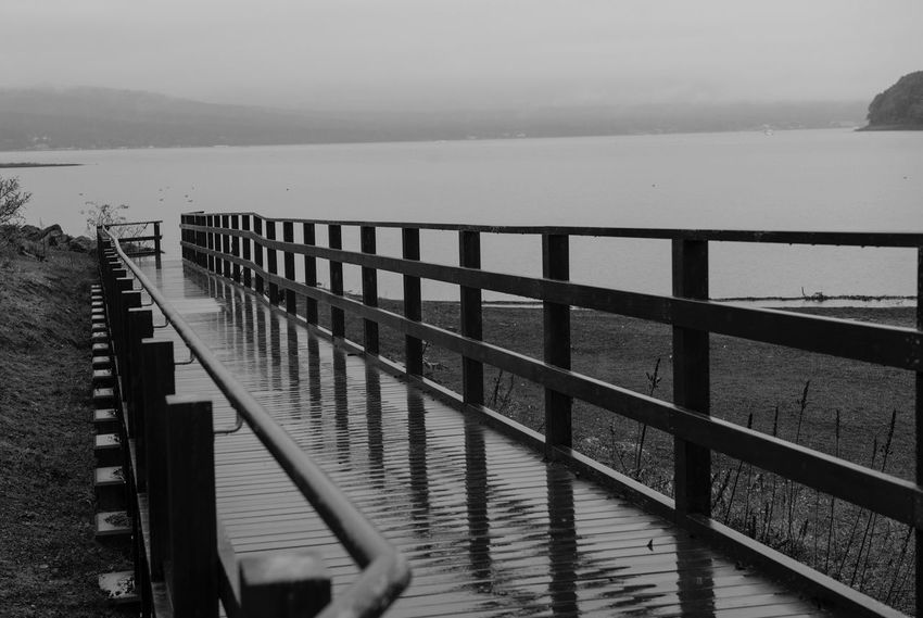 Water Railing Sea Pier Nature Wood - Material Outdoors Day Tranquil Scene Mountain Tranquility Scenics No People Jetty Wood Paneling Beauty In Nature Sky Clear Sky Fishing Pole