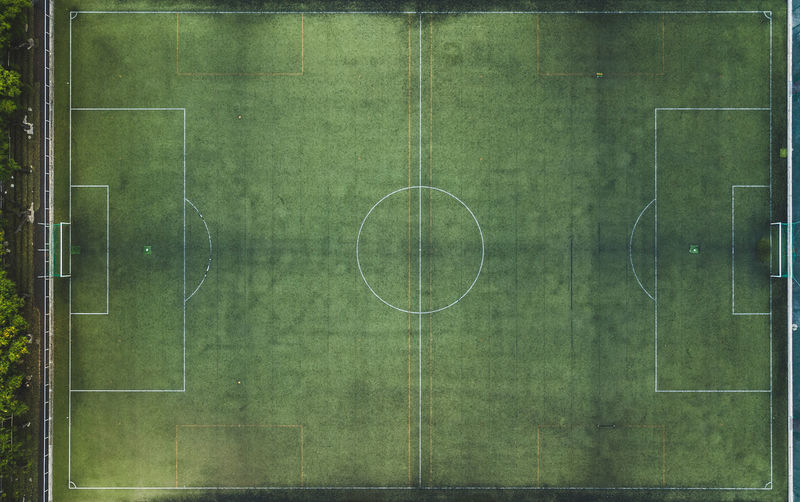 Top view of a soccer field. Football Above Aerial View Competition Competitive Sport Day Football Field Geometric Shape Grass Area Green Color Leisure Activity No People Outdoors Playing Field Recreational Pursuit Soccer Soccer Field Sport Top Perspective Top View