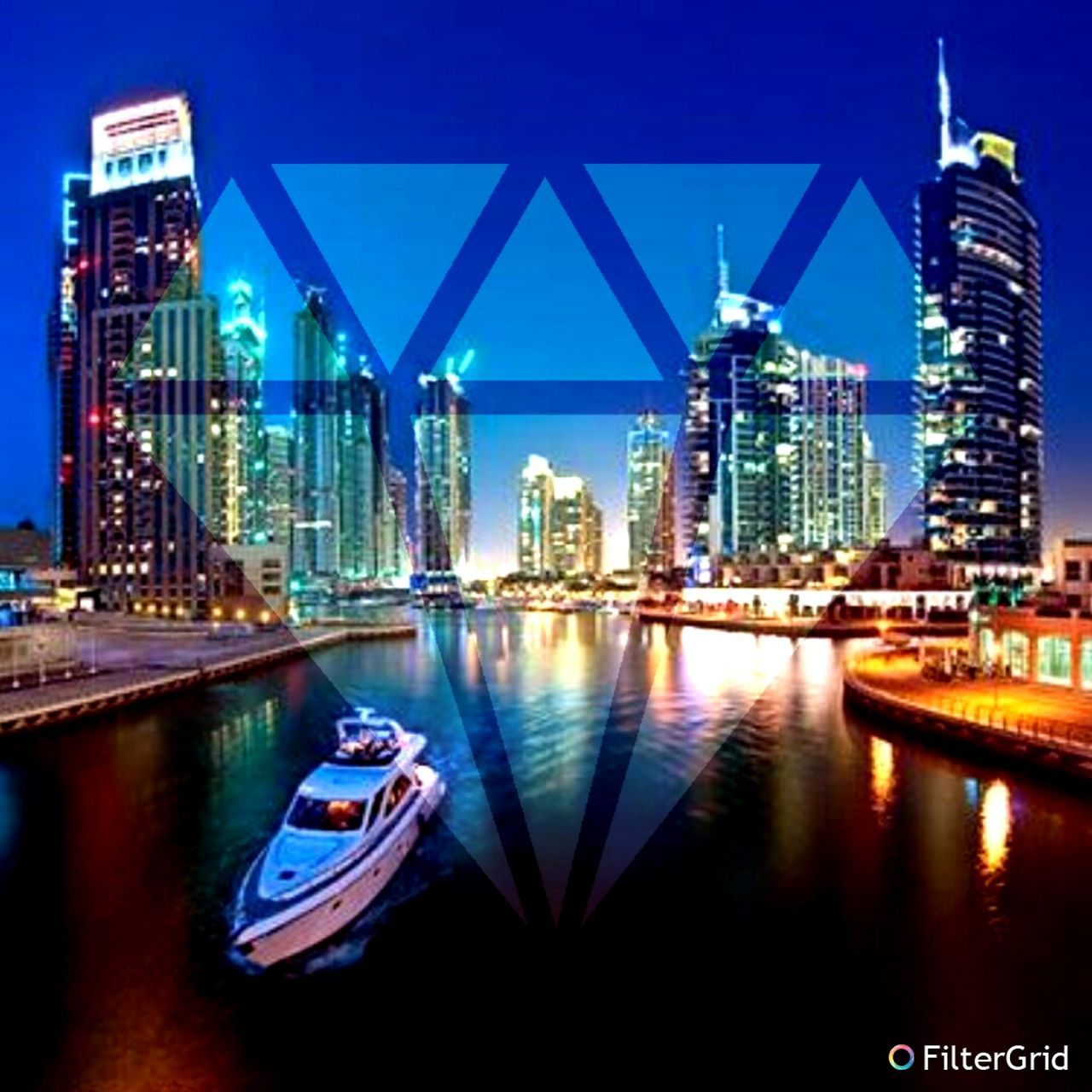 skyscraper, building exterior, architecture, city, urban skyline, cityscape, modern, night, travel destinations, reflection, built structure, illuminated, water, waterfront, tower, downtown district, development, river, outdoors, city life, blue, no people, nautical vessel, sky, clear sky