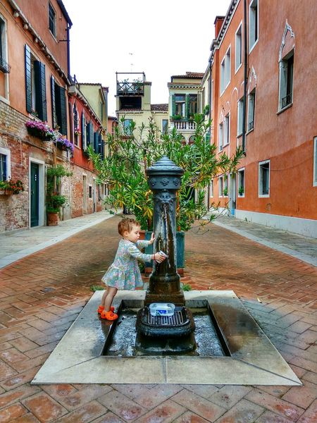 Venice Venice, Italy Child Building Exterior Childhood Young Women Day Fountain Venetian People Venetian Architecture Venetian Water Plant Real People Care Adapted To The City Women Around The World The Portraitist - 2017 EyeEm Awards EyeEmPaid Be. Ready. Rethink Things