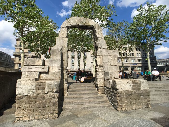 Old roman arch, next to Cologne cathedral EDITORIAL USE ONLY Cologne , Köln,  Summer Tourism Cologne Köln Landmark Tourist Attraction  Roman Arch Roman Arch Outdoors Germany Architecture Tree Built Structure Sunlight Group Of People Building Exterior Day Real People The Past History People