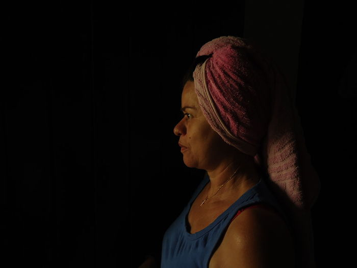 Close-up of woman with towel on head