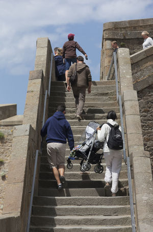 People climbing steps in old town of Saint-Malo, France. Parents are carrying a chicco baby stroller with their child upstairs. Ancient Ancient Architecture Architecture Baby Stroller Brittany Buggy Carrying Climbing France Full Length Handicap Mobility Moving Up Parenthood Parents People Saint-Malo Steps Steps Steps And Staircases Streetphotography Stroller Teamwork Upstairs Young Adult