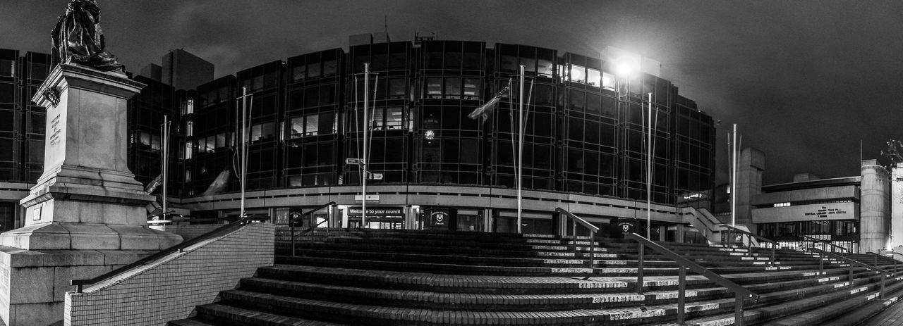 Steps Outside Modern Buildings In City Against Sky
