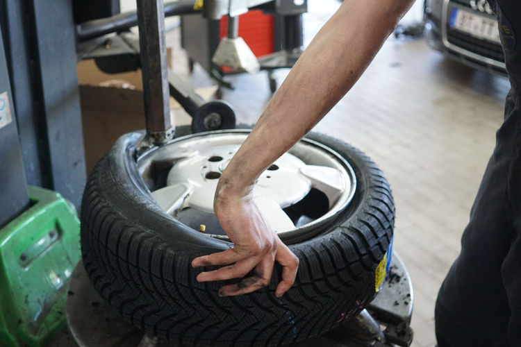 Changing car tyre in an auto repair shop Auto Repair Cars Changing Mechanic Mechanical Repairing Tires Transport Transportation Wheel Auto Repair Shop Car Car Tire Car Tyre Garage Mode Of Transport Mode Of Transportation Tire Tyre Tyres Vehicle Vehicle Part Wheel Rim Wheel Rims Wheels