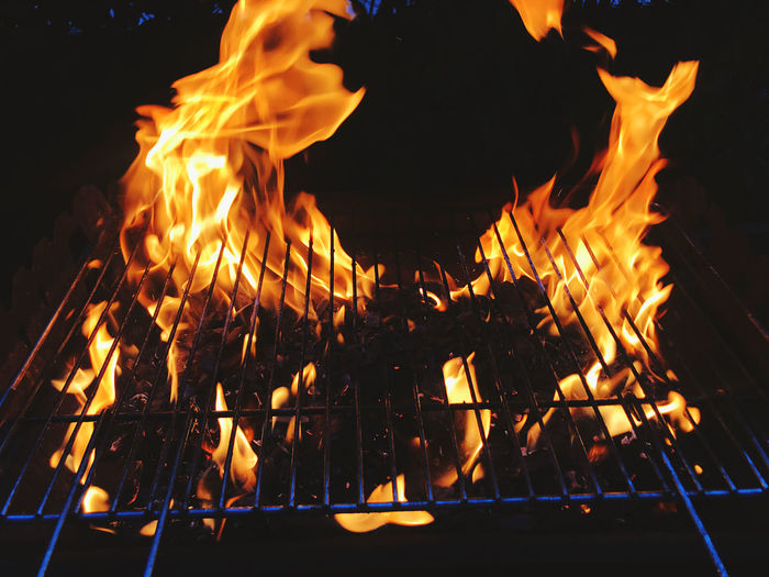 Close-up of bonfire against fire at night