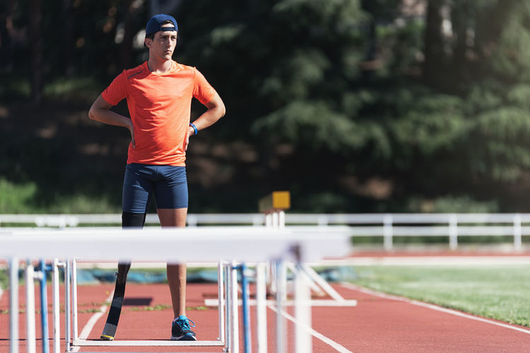Man With Artificial Leg Standing On Running Track