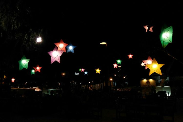 color full stars on the night Background Night Star Lights Colorful Lamps Lamps And Lights. Illuminated City Celebration Lantern Arts Culture And Entertainment Sky Electric Bulb