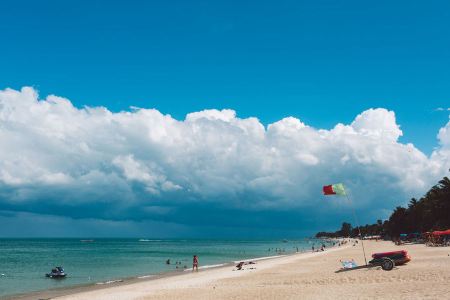Sky Sea Beach Water Cloud - Sky Land Sand Nature Beauty In Nature Scenics - Nature Day Holiday Horizon Horizon Over Water Incidental People Trip Vacations Group Of People Tranquility Outdoors