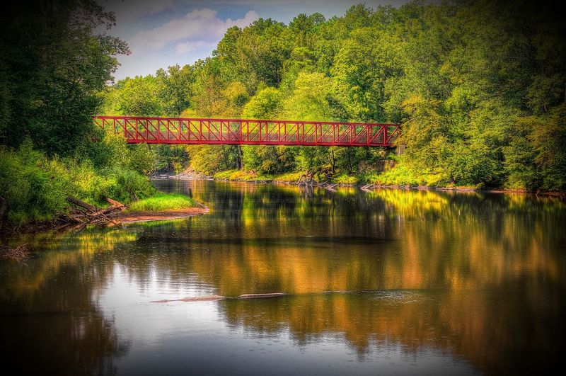 Red Bridge Architecture Beauty In Nature Bridge - Man Made Structure Built Structure Connection Day Growth Lake Lithia Springs, GA Nature No People Outdoors Red Bridge Reflection Scenics Sky Tranquility Tree Water
