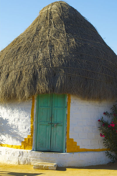 Thatched House in That Desert, India Desert Travel Photography Architecture Beauty In Nature Building Exterior Built Structure Cottage Day Desert Homes Flower House India Travel Nature No People Outdoors Thatched Cottage Thatched Cottage Country Cottage Thatched Roof Travel Destinations Travel Photos