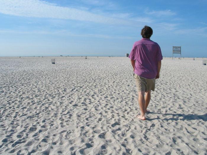 Full length of woman standing on shore
