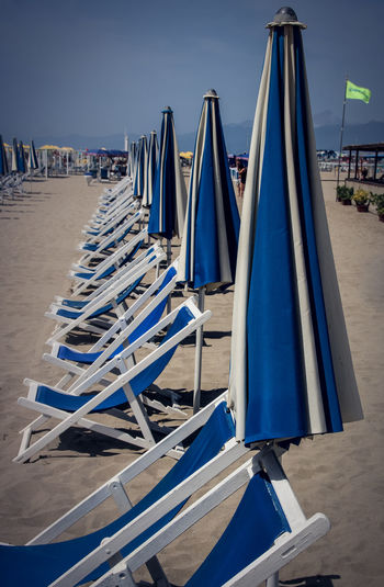 Holidays Sitting Beach Blue Day Deckchair Group Of Objects In A Row Large Group Of Objects Nature No People Outdoors Sand Sea Sky Water Summer Exploratorium