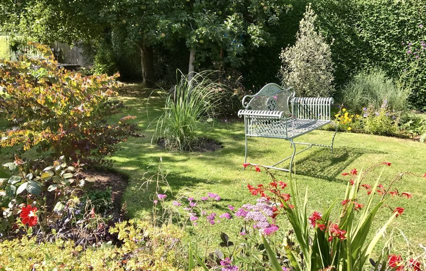 Dahlias Graceful Garden Seat Grasses And Heleniums Grasses And Sun Late Summer Colours Runner Bean Plants And Flowers A Place To Relax Oranges, Reds, Yellows And Purples