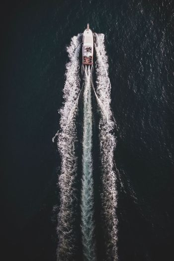 Aerial view of motorboat sailing on sea