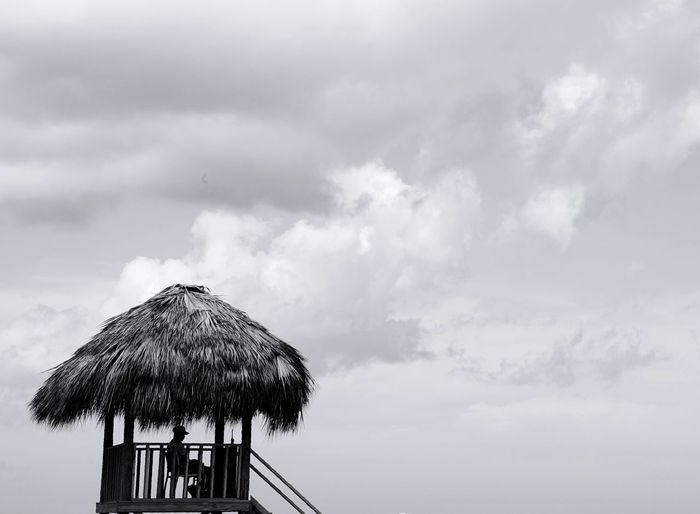 lifeguard hard at work Hut Life Guard Dominicanrepublic Puntacana Resort Life Guard Post Monochrome Blackandwhite Sky Cloud - Sky Thatched Roof Low Angle View Summer Sky Tropical Climate Outdoors Vacations Day Beach Sea Nature Beauty In Nature