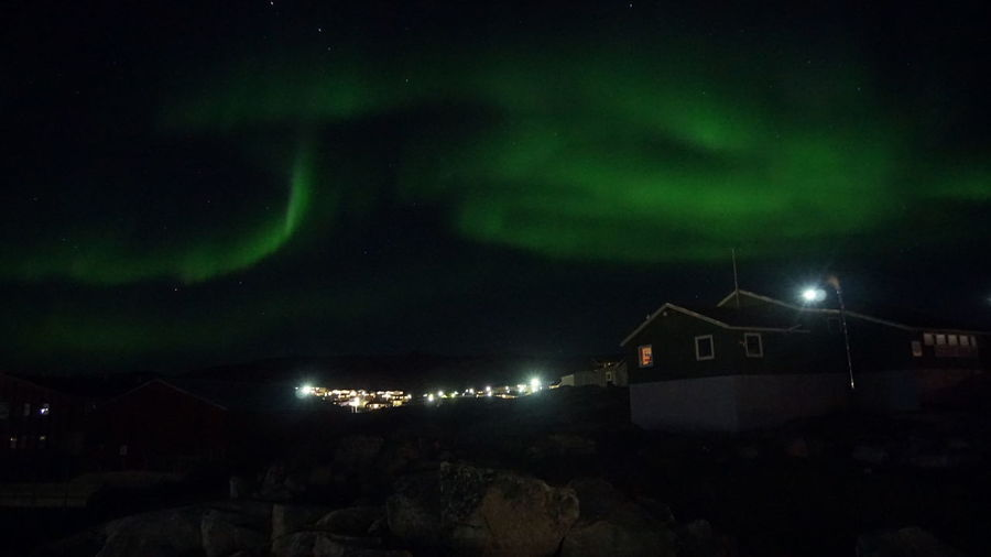 The Northern Lights Dance over the town. Aurora Aurora Borealis EyeEm Best Shots EyeEm Best Shots - Nature Ilulissat Nature Nature Photography Northern Lights The Real Greenland This Is Greenland Beauty In Nature Building Nature_collection Night No People Outdoors Power In Nature Sky