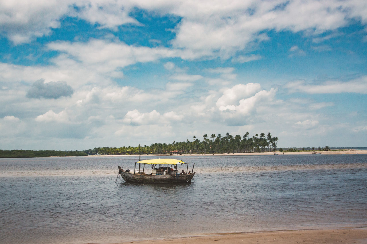 cloud - sky, water, sky, nautical vessel, transportation, mode of transportation, sea, waterfront, scenics - nature, nature, beauty in nature, day, tranquil scene, tranquility, land, outdoors, beach, no people, travel