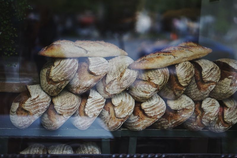 Baked Breads At Store Seen Through Glass