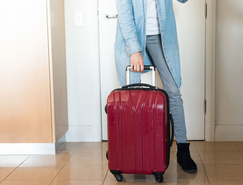 Woman with red suitcase Adult Arrival Casual Clothing Flooring Holding Holiday Human Body Part Indoors  Jeans Journey Leaving Lifestyles Low Section Luggage One Person Standing Suitcase Tiled Floor Travel Trip Vacations Waiting