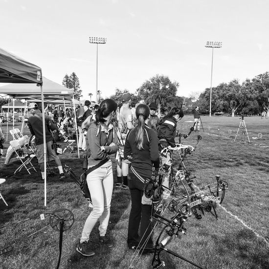 Preparation leads to confidence Archery Competition Saturday Morning Leisure Time Blackandwhite Photography Urban Exploration Outdoors Full Length Friendship Young Women Teamwork Real People