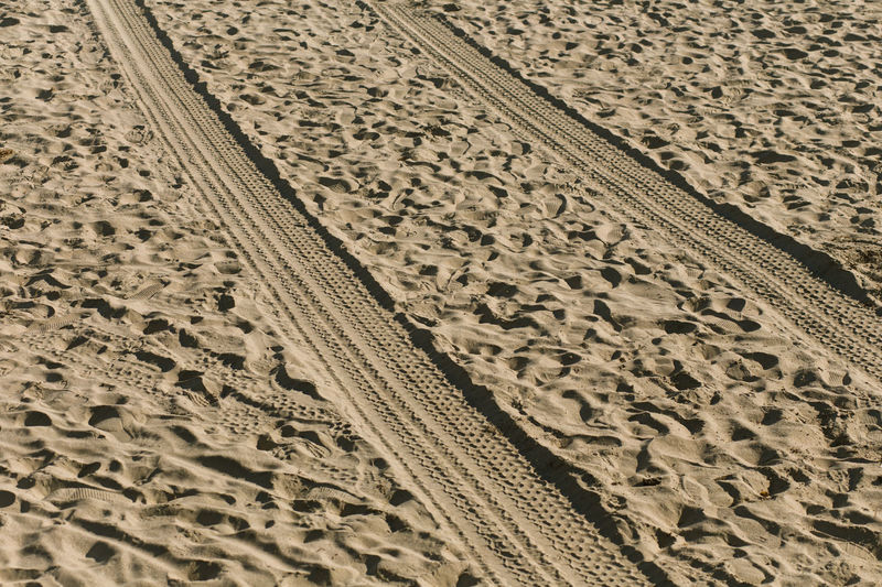 Close-Up Of Tire Tracks On Sand