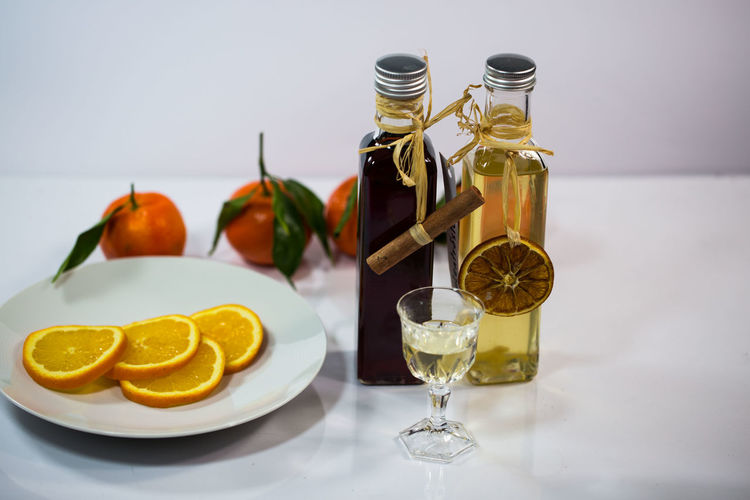 Liqueur Food And Drink Food Still Life Citrus Fruit Fruit Freshness Table Healthy Eating Lemon Indoors  No People Plate Wellbeing Glass Refreshment Drink Container Bottle SLICE Ready-to-eat Orange