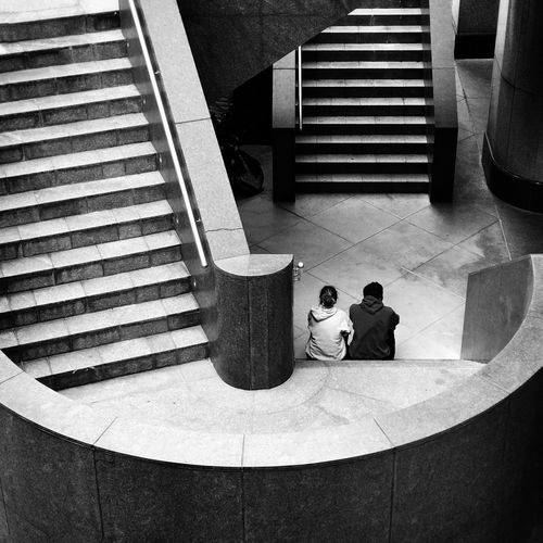 Romance in the concrete jungle Streetphotography Staircase High Angle View Steps And Staircases Steps Built Structure Architecture Spiral Staircase People Pattern, Texture, Shape And Form City Life Lovers Urban Geometry Friends Urban Outdoors Monochrome The City Light Welcome To Black Long Goodbye The Secret Spaces Break The Mold TCPM The Street Photographer - 2017 EyeEm Awards The Architect - 2017 EyeEm Awards Breathing Space Second Acts Black And White Friday The Graphic City Stories From The City A New Beginning Moments Of Happiness #NotYourCliche Love Letter Streetwise Photography