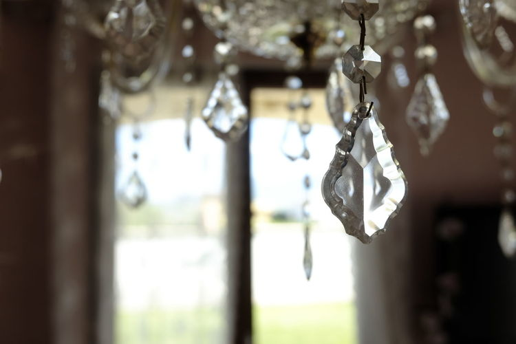crystal chandelier drops detail Hanging Focus On Foreground No People Selective Focus Close-up Decoration Jewelry Day Indoors  Creativity Art And Craft Window Design Crystal Lighting Equipment Metal Emotion Craft Luxury Personal Accessory Ornate Chandelier