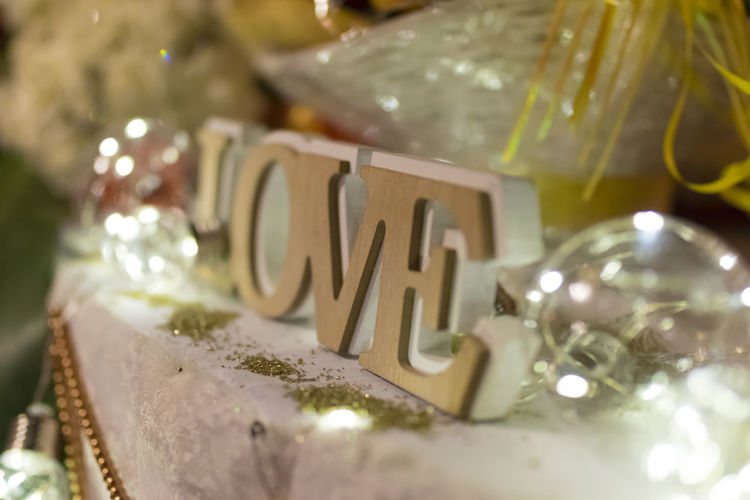 Selective Focus Text Celebration Close-up No People Table High Angle View Love Day Decoration Background Light Valentines Day Wooden Valentine Background Blurred Bulb Light Backdrop Event Gift Wedding Photography