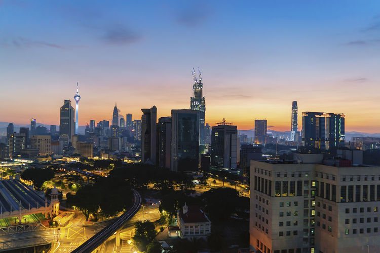 Aerial view of sunrise at Kuala Lumpur city skyline horizon. Aerial Building Exterior Built Structure Architecture City Building Sky Office Building Exterior Cityscape Skyscraper Tall - High Tower Urban Skyline No People Landscape Modern Nature Sunset Travel Destinations Residential District Office Outdoors Financial District  Spire  Aerial