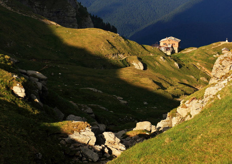 House on mountain at bucegi natural park during sunny day