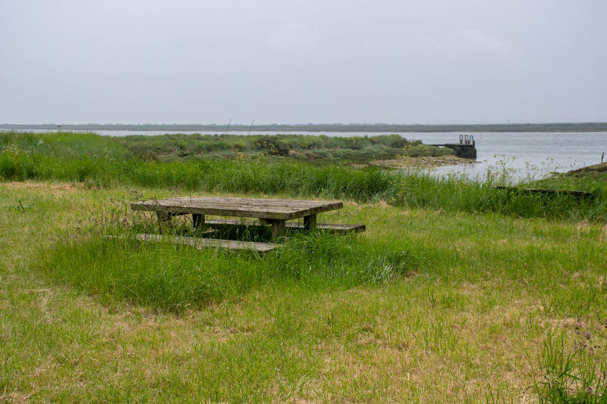 Empty Bench overlooking English Estuary Bench Creek Beauty In Nature Estuary Grass No People Outdoors River Scenics - Nature Solitude Tranquil Scene Tranquility