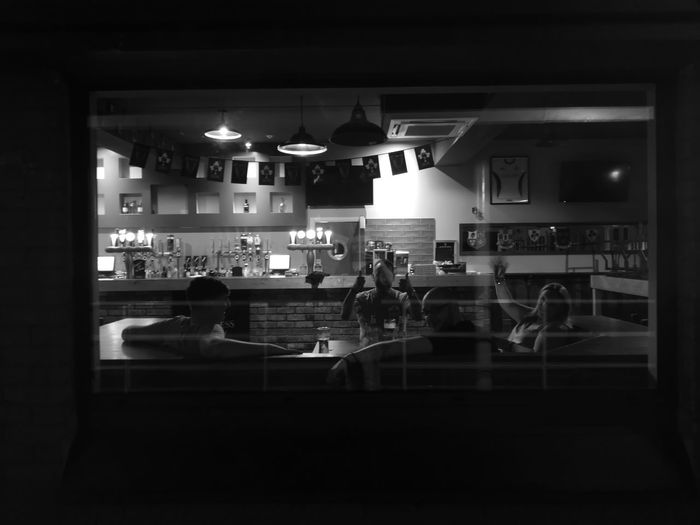 After the general public leave. Tiredness Happiness Work End Of Shift Happy Hour Illuminated Bar - Drink Establishment Sitting Bartender Friendship Nightlife Food And Drink Industry Drink Bar Counter HUAWEI Photo Award: After Dark