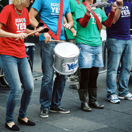 A group of Yes campaign supporters play music on Glasgow's Argyle Street on the day of the 2014 Independence Referendum. Adult Argyle Street Campaign Cooperation Day Democracy Drum - Percussion Instrument Drummer Drumming Glasgow  Independence Music Outdoors Passion Political Rally Real People Referendum Scotland Scottish Independence Snp Teamwork Togetherness Yes Yes Campaign