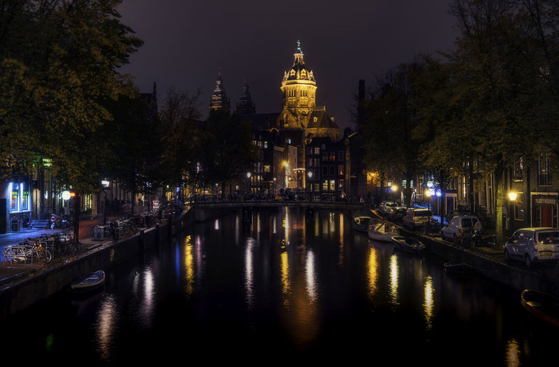 Amsterdam City Lights At Night Europe Trip Reflection Remo SCarfo Architecture Bridge - Man Made Structure Building Exterior Built Structure City Color Dutch Histrorical Building Holland Illuminated Mode Of Transport Nature Nautical Vessel Night No People Outdoors Reflection Reflections In The Water River Sky Transportation Travel Destinations Tree Water Waterfront