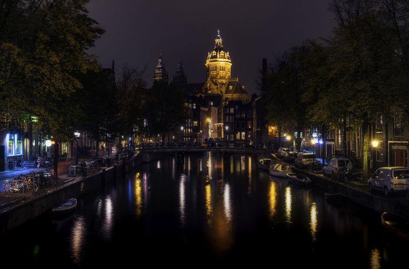 View Of Illuminated Bridge Over River At Night