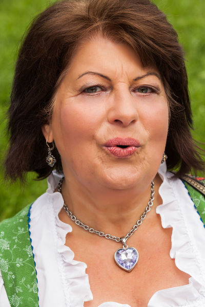 Portrait of a bavarian woman in middle age, the whistles with high spirits, Lady Traditional Clothing Adult Adults Only Beautiful Woman Businesswoman Close-up Day Dirndl Female Front View Headshot Lifestyles Madam Mature Adult Mature Women Necklace One Person One Woman Only Outdoors People Person Real People Whistle Women