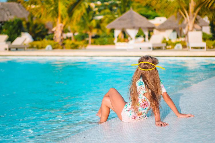 Woman enjoying in swimming pool