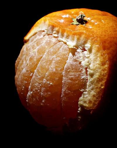 Close-Up Of Fresh Orange Against Black Background