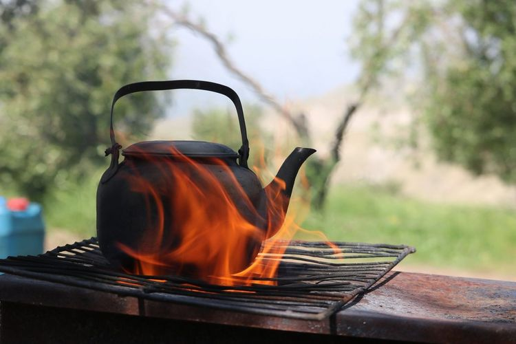 Close-up of burning tea kettle