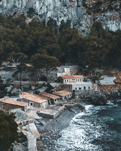 Sa Calobra in Mallorca Architecture Built Structure Building Exterior Water Building Nature No People Outdoors House Mountain Motion Land Flowing Water TOWNSCAPE Old Town Boathouse Sea Wave Waves Waves, Ocean, Nature Forest Tree Tranquility Lonely